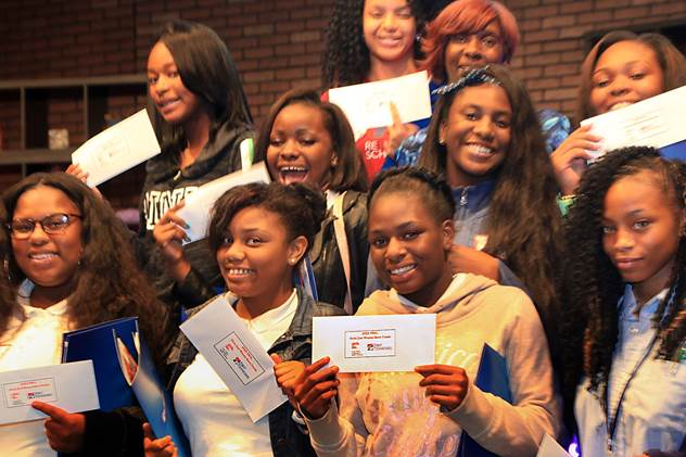 Girls Inc students showing off their new $2 bills
