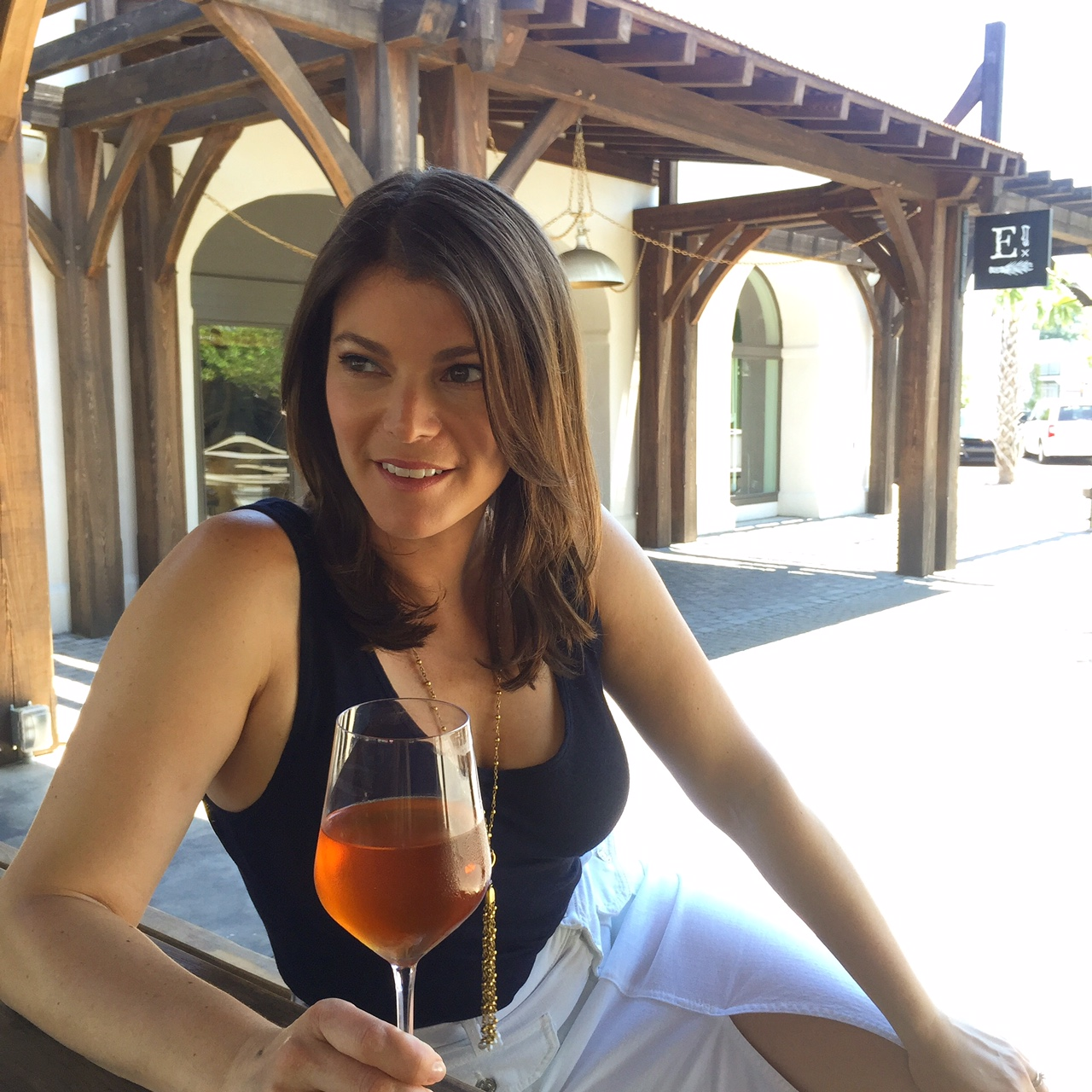 gail simmons from top chef holds glass of wine