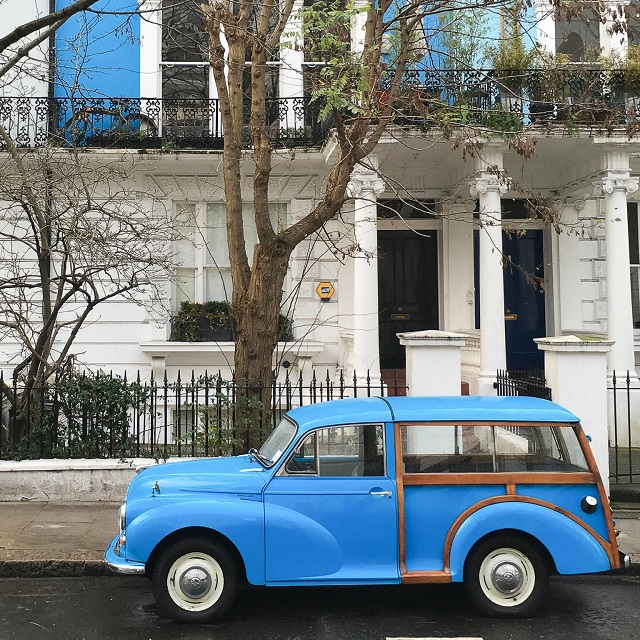 blue car outside house in London